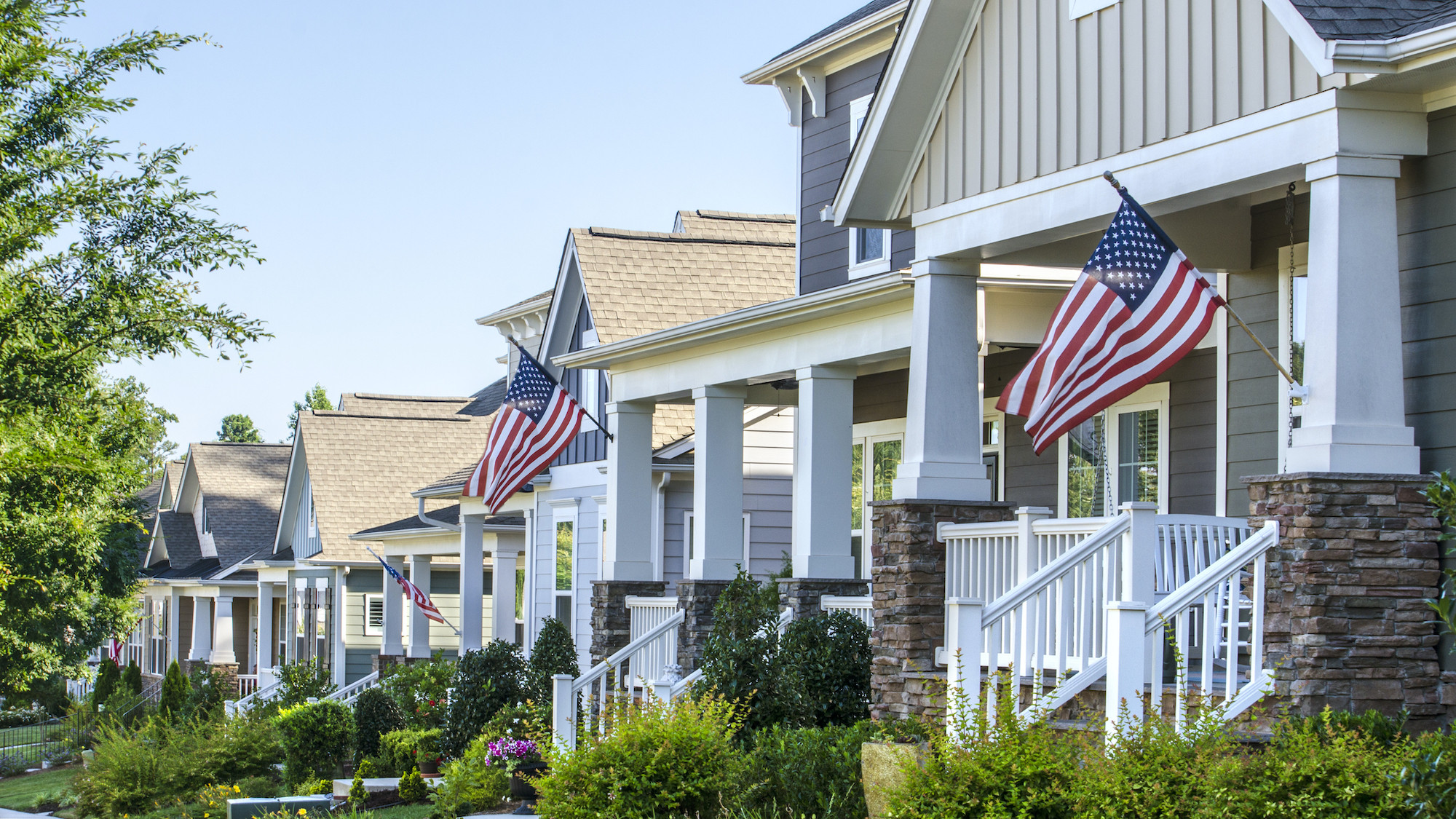 Suburban homes with flags